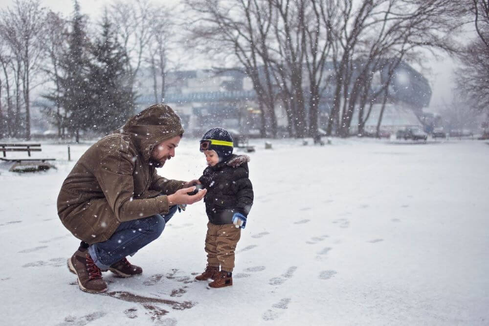 father-and-toddler-outside-in-snow