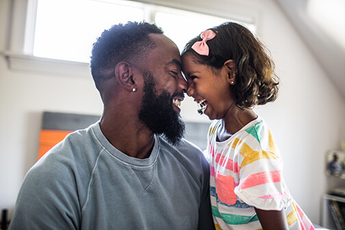 father-and-young-daughter-smiling