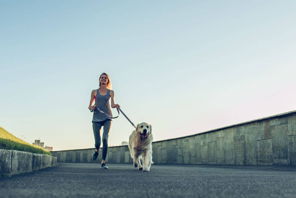 woman-running-with-dog