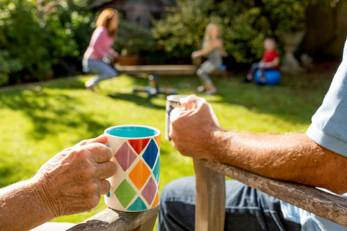family-playing-in-grandparents-backyard