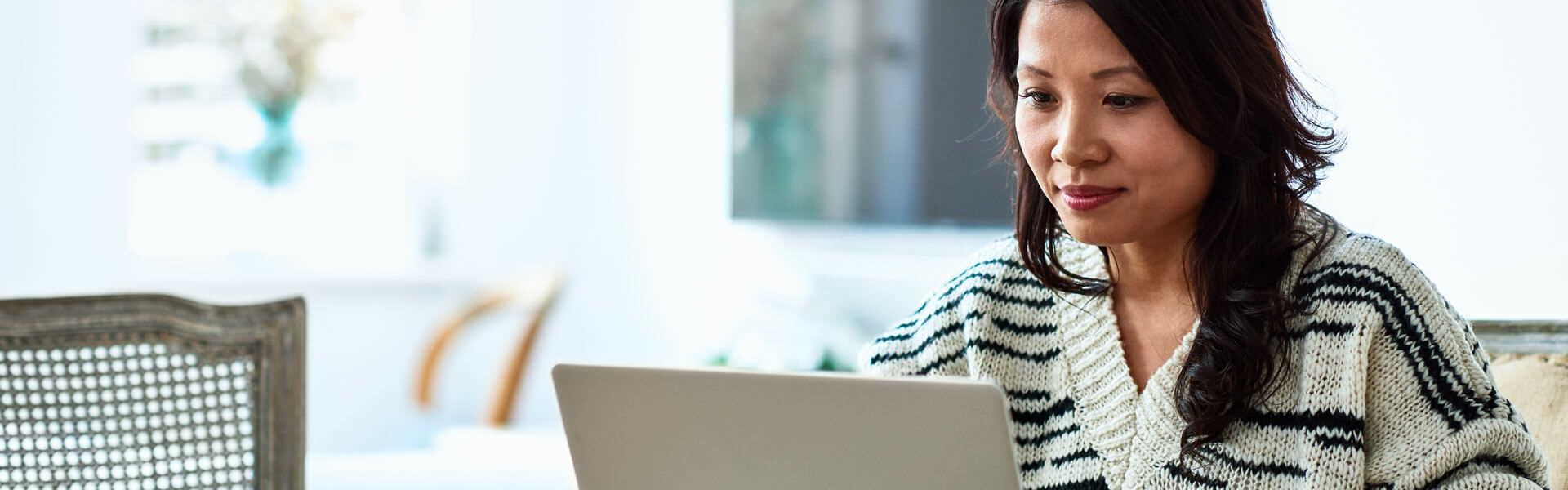 woman-looking-at-laptop